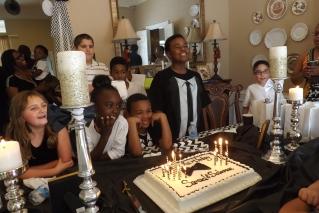 Singing happy birthday to the boys.